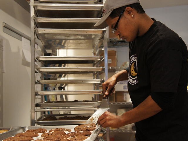 Manager Rafi Safadit prepares cookies for sale at the newly-opened Insomnia Cookies on the Upper East Side.