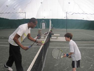 Tennis coach Jamie Moore works with a student at Sportime. Mark McEnroe, general manager of Sportime's Randall's Island site and the John McEnroe tennis academy, said he wants to increase outreach.