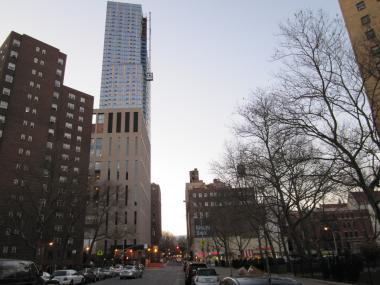 Mt. Sinai Hospital's new luxury apartment tower soars over East Harlem from East 102nd Street.