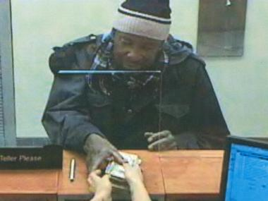 Police are looking for this man, accused of two attempted and one successful bank robbery Dec. 23, 2011.