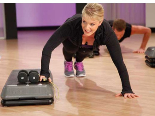Fitness expert Kristi Molinaro demonstrates pushups on a raised step, part of her regimen at 306090 fitness.