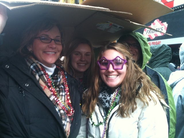 Tanna Wagner (l), Allie Wagner and Kate Gartner, from Redding, Pa, shelter from the rain in Times Square Dec. 31 2011.