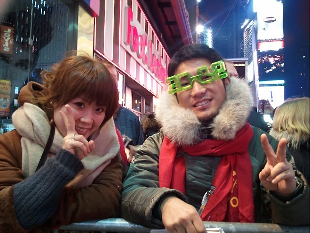 Takahiro Tomiyasu, 27, a sailor from Fukuoka, Japan and his girlfriend Shirai Kanna, 30 ring in the New Year in Times Square on Dec. 31, 2011.