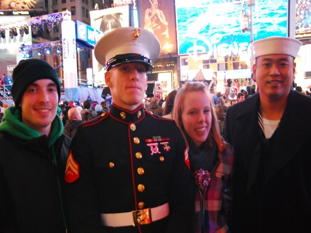 Donald Garrell, Jr., Cpl. Mike Basso, Kelly Wisnewski and Petty Officer 2nd Class Paolo Flores spent New Year's 2012 in the center of Times Square.