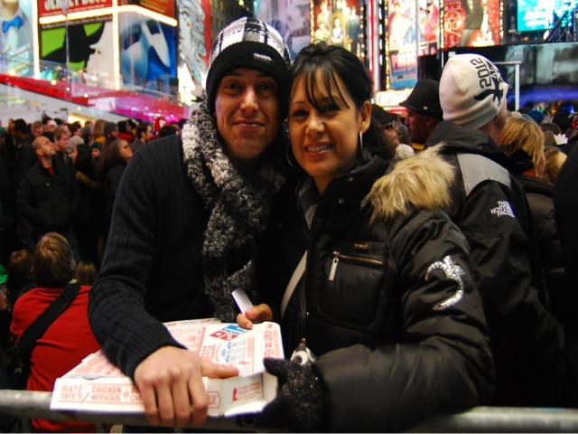 Massimo Coscarella and Claudia Hernandez came from Toronto to spend New Year's 2012 in Times Square. They spent $20 on a medium Domino's pizza because there were few other options.