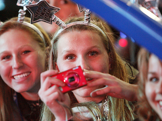 Revelers catch all the magic moments on New Year's Eve in Times Square, 2011.