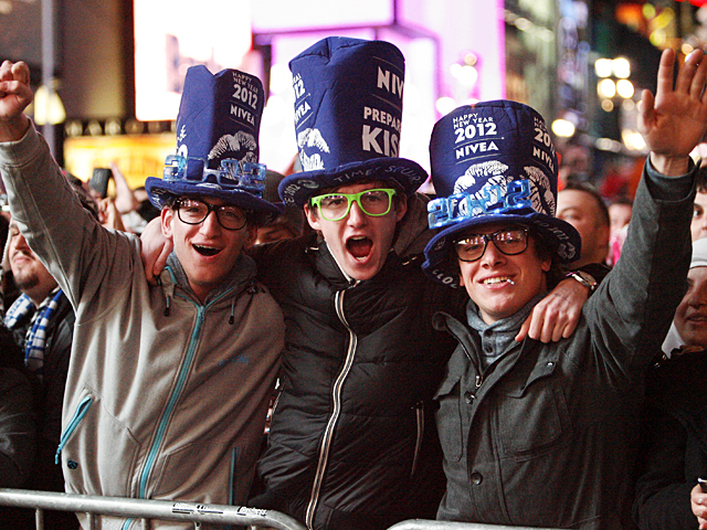 A group of guys celebrate the New Year in Times Square, 2011.