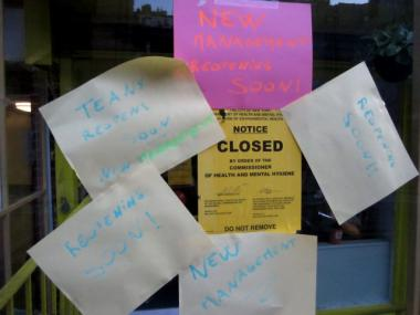 Signs outside Teany Cafe said it would reopen under new management.