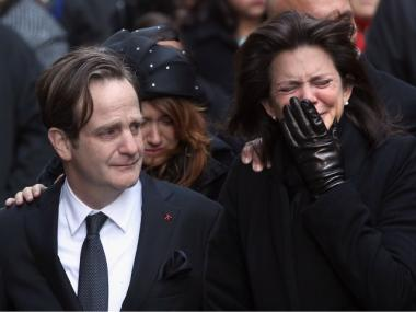 Matthew and Madonna Badger watch as the caskets carrying the bodies of their three daughters arrive for funeral services on January 5, 2012