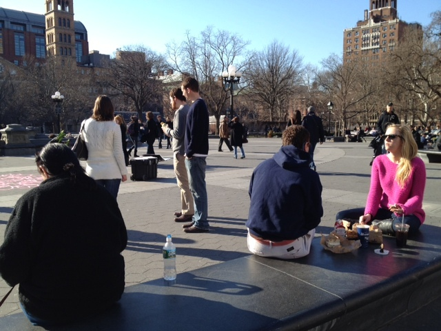 Visitors to Washington Square Park basked in the sun on Sat., Jan. 7, 2012, when the temperature topped out at 59 degrees.