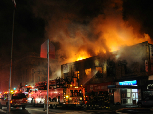 Several business owners stood on the street watching as flames lapped at their businesses, which include Bread and Yoga studio, Dichter's Pharmacy, Burhan Hardware, Furry Friends, Splash Laundromat, Bank of America, Citibank, a dentist office, a lawyer's office and China Buffet, a restaurant that closed over the summer.