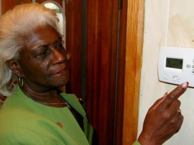 Bronx Deputy Borough President Aurelia Greene points out on Jan. 10, 2012 a new programmable thermostat she had installed after receiving an energy audit. Greene said that before her home energy improvements she kept the heat set at 81 degrees; now it is set to 75 degrees.