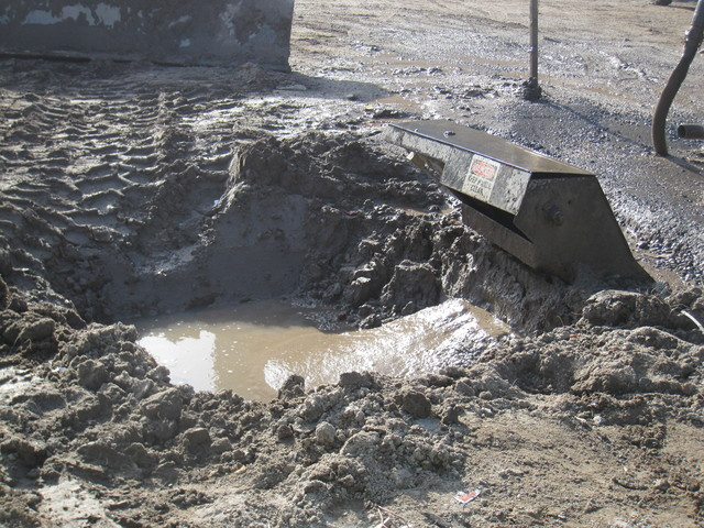 <p>The muck from the wheel washer is collected in this pit and disposed of separately.</p>