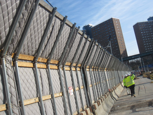 <p>The fences are designed with blankets to blunt construction noise.</p>