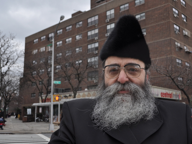 Rabbi David Niederman stood in front of Kent Housing to express outrage at a recently found swastika in the elevator.