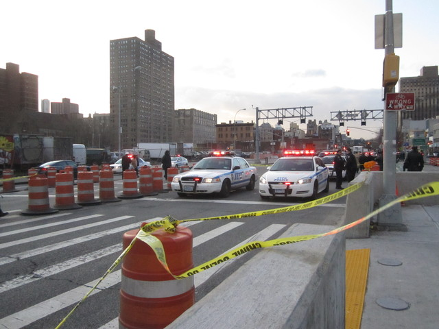 Police blocked off two lanes of Delancey Street where a 12-year-old girl was killed Jan. 13, 2012.