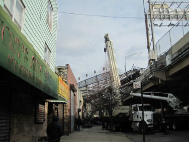 Crews worked to clean up debris from the billboard collapse on Meeker Avenue a day after the Fri., Jan. 13, 2012, incident.