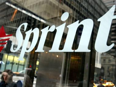 A Sprint sign is seen October 23, 2003 in New York City. Sprint Corp. posted a consolidated net loss for the third quarter of $498 million.