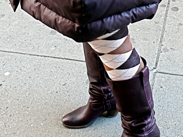 Argyle tights with flat boots and a down winter coat on University Place.