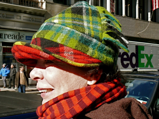 Dympna B. in a mixed tartan hat  and cashmere stripes on Broadway.