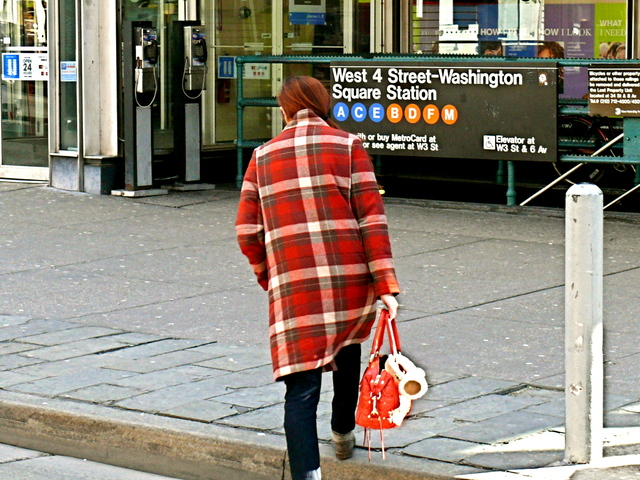 Bold red tartan and red accessories on Sixth Avenue in West Village.