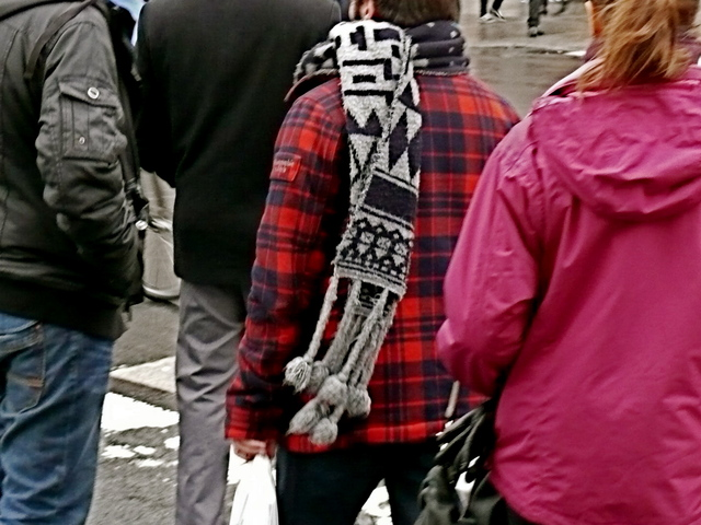 Bold red and black hunter jacket with tribal style knit scarf on Union Square.