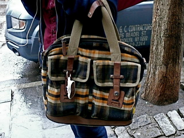 Big, bold plaid tote with canvas and leather details on Sixth Avenue, West Village.