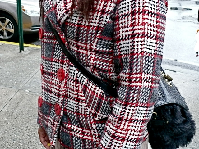 Detail of Deona G's bold choice accessory worn with checks in the West Village.