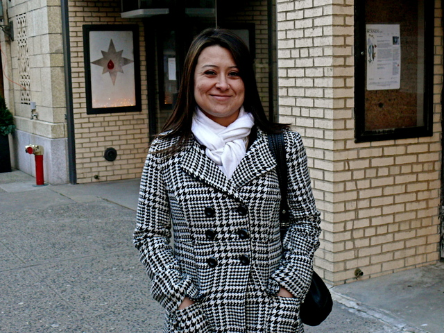 Chrystal G. in a double breasted houndstooth check jacket, worn on Waverley Place.