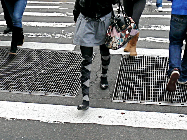 Argyle tights highlight a short drop waisted skirt and flats on Grand Street SoHo.