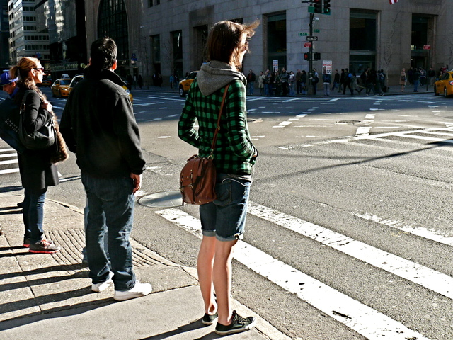 Brave and bold graphic green and black checks with knit hoodie on Fifth Avenue and 57th Street.