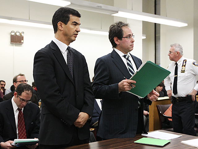 Council member Ydanis Rodriguez (l.) and his attorney Andrew Stoll appear in Manhattan Criminal Court on Jan. 20th, 2012.