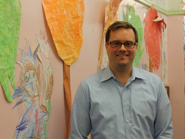 <p>Bob Bender, principal of P.S. 11, in the hallway of the school.</p>