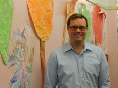 Bob Bender, principal of P.S. 11, in the hallway of the school.