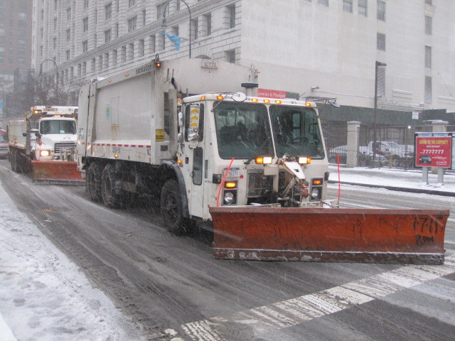 <p>Snowplows lined East 14th Street on Sat., Jan, 21, in preparation for the storm.</p>
