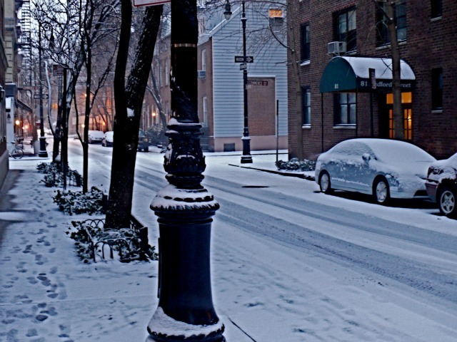 <p>Snow blanketed the corner of Bedford and Commerce streets in the West Village on Sat., Jan. 21, 2012.</p>