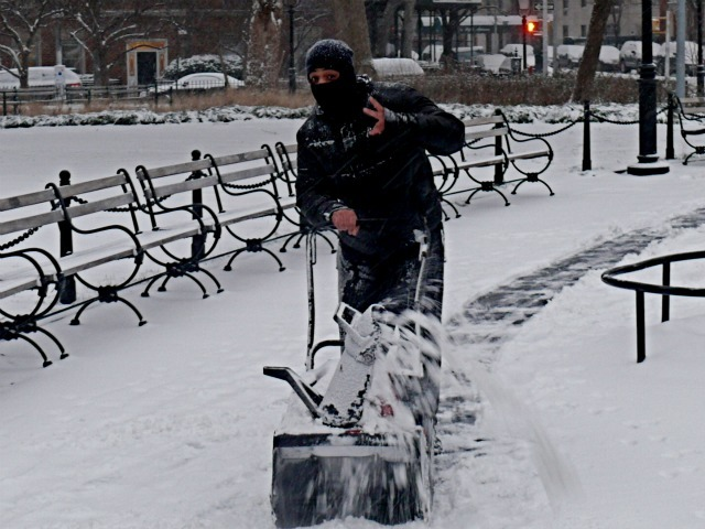 <p>A man pushes a snow-blower in Washington Square Park on Sat., Jan. 21, 2012.</p>