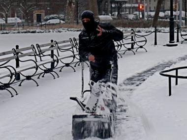 Up to 5 inches of snow were expected to fall as part of the city's first snowstorm of the season.