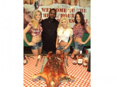 Southern-inspired gals pose with a pig — and a pitmaster — at the Beer, Bourbon and BBQ Festival.