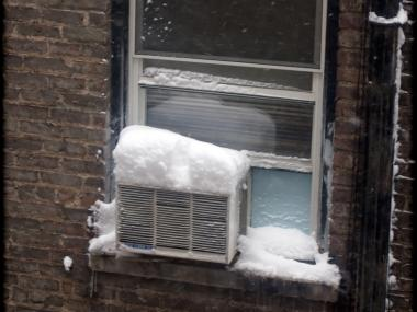 Cops say a burglar is getting into apartments by pushing in AC units left in during the winter.