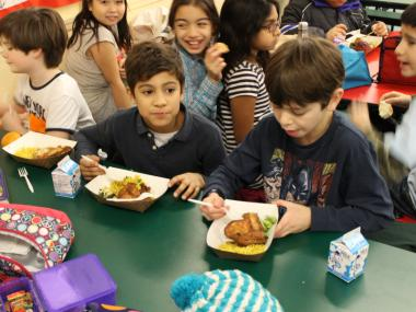 Fourth-graders Kai and Jonah enjoy their lunch at P.S. 11.