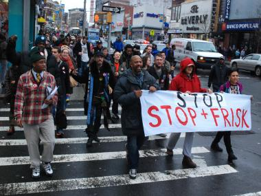 Protesters march in Mott Haven on Jan. 27, 2012 to denounce the police policy of stop, frisk and question.