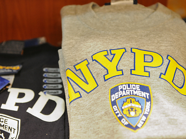 Police Commissioner Raymond Kelly banned off duty police from wearing clothing with an NYPD logos or insignia.