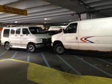 An image of the vans allegedly driven by the victims who landed in the hospital with head trauma after a shopping cart fell on them on Jan. 30, 2012.