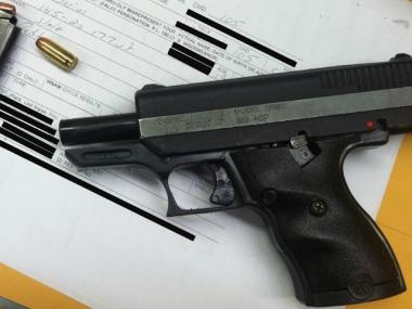 Police recovered a handgun after tracking down an armed robber who allegedly stole a man's iPhone and iPad on Thurs., Feb. 2, 2012.