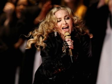 Singer Madonna performs during the Bridgestone Super Bowl XLVI Halftime Show at Lucas Oil Stadium on February 5, 2012 in Indianapolis, Indiana.