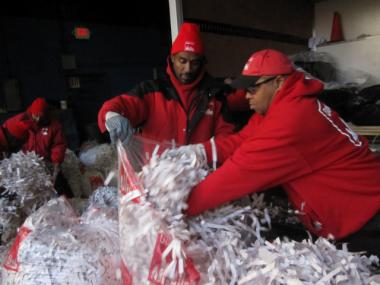 Workers stuffed bags of confetti one day before the Giants' Feb. 7, 2012 Super Bowl parade.