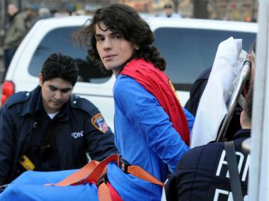 A man dressed as Superman scaled the statue of George Washington in Union Square on Monday, Feb. 6, 2012, before he was handcuffed and strapped to a gurney by police.