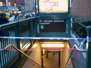 Police tape blocks entry to the 77th Street station on the Lexington Avenue line after a man was struck and killed there on Feb. 6, 2012.