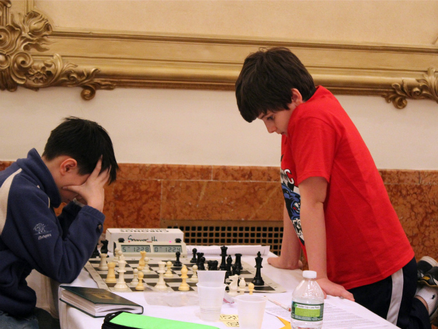 <p>Spencer Ha, at left, and 10-year-old Maxwell Beem, from the Browning School, faced off at the city championships.</p>